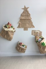 Sandy Duffield has made Christmas decorations out of the brown paper bags that meals are delivered in.