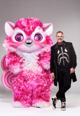 Designer Tim Chappel with one of his larger-than-life costumes that a mystery celebrity will wear in the new season of The Masked Singer