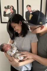 Li Tan and Barney Ong with their son, Julian.