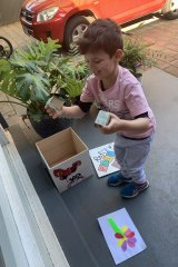 Jamila's four-year-old son painting his 'kids-only' post box.