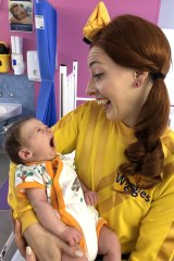 Emma Wiggle meeting one of the tiny patients at the Sydney Children's Hospital, Randwick, on Christmas Day.