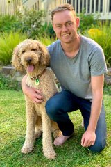 Chad Neylon from Ringwood,with his dog Graham. The Sydney outbreak has meant Neylon won't be able to fly to Perth or even go to a family Christmas event in Melbourne.