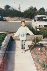 A childhood Zoë rocks the '80s trifecta of oversized sloppy joe,  acid-wash denim and skipping rope.