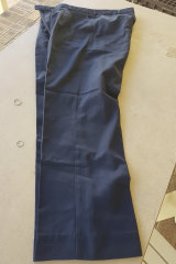 Telstra-issued work trousers from around the 1990s period. State prosecutors argue the fibres pulled from tape lifts by forensics officers match the same brand of pants.