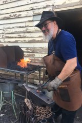 Blacksmith Stephen Hogwood plies his trade at the old stables.