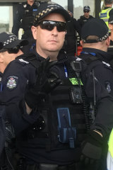 Police have denied that  Senior Constable Travis Gray's hand gesture was used as a 'white power' symbol.