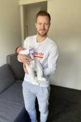 Melbourne City captain Scott Jamieson with son Cooper Alexander.