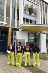 Firefighters outside the ACT Legislative Assembly, where they spoke to politicians this week about the industrial action they are taking against ACT Fire and Rescue.