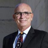 WA Attorney General John Quigley.