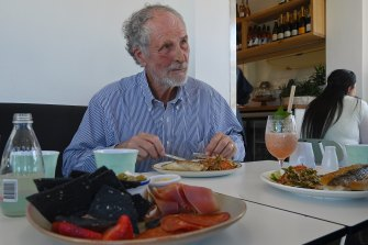 Andrew FitzSimons, principal of Dapto High School, eating the pan-fried local snapper.
