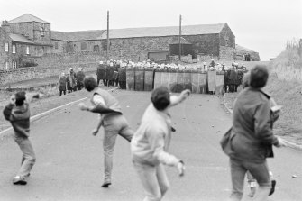 Clashes between striking miners and police in the town of Woolley, England in 1984.