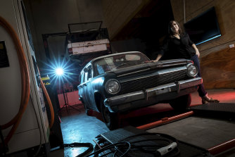 EVolution Australia's Emma Sutcliffe with the 1963 EJ Holden wagon she is turning electric.
