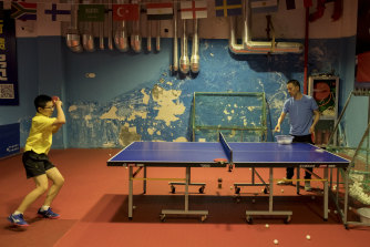 Jian Fay Lay's former teammate Lin Tie, right, coaches a student at a local club in Pingyang, Wenzhou, on Saturday.