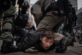 A pro-democracy protester in Hong Kong is tackled and arrested by police in September, 2019.