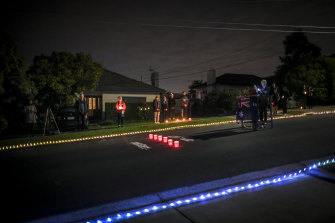 Residents of Clara Street in Macleod, in Melbourne's north-east, set up a makeshift stage for a dawn service on Anzac Day, 2020.