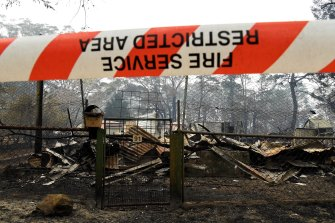 The remains of a house in Wingello. The Australian Academy of Sciences says any bushfire response must extend beyond rebuilding.
