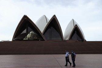 Police patrol lockdown rules outside the Sydney Opera House.