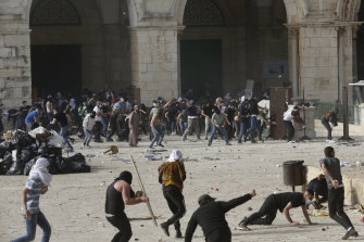 Police entered the compound, firing tear gas, rubber-coated steel pellets and stun grenades.
