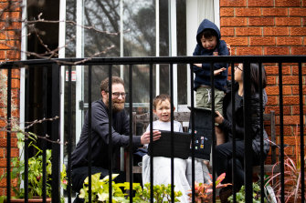 Lockdown lesson ... Justine Toh and Vaughan Olliffe are home-schooling their children, Caleb, 5, left, and Rhys, 7, in their small Sydney apartment.