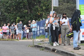 People queue for COVID tests at Mona Vale in Sydney.