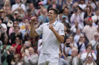Poland's Hubert Hurkacz celebrates after defeating Roger Federer.