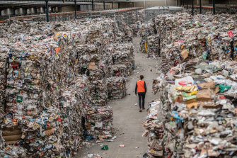 Mounting up: Bales of recycling waste at an SKM warehouse in Melbourne before the company collapsed.