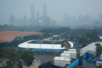 Melbourne's skyline is shrouded in bushfire smoke haze, with Melbourne Park, where Australian Open qualifying is taking place, in the foreground.