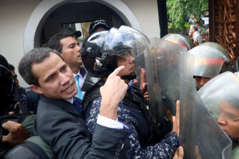 Guaido eventually forced his way past the riot shields of the troops and into parliament.