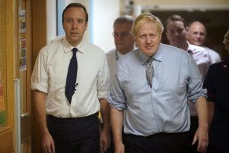 UK Health Secretary Matt Hancock (left) and Prime Minister Boris Johnson.