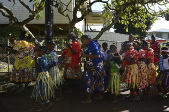 Community members, elders and school children sing during the Mabo Day parade along a street on Boigu Island in the Torres Strait celebrating the first successful native title claim on June 3rd 1992.