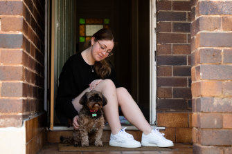 """HSC student Jessica Grimes with her dog Jazi is struggling with the isolation. """"Learning from home is really difficult because I find it hard to get out of bed every morning and get out of it - I feel like I'm stuck in a prison cell."""""""