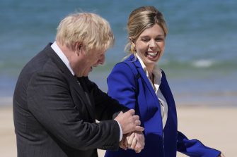 """British Prime Minister Boris Johnson and his wife Carrie walk on the boardwalk during G7 on June 12 in St Ives, England.  In a post on Instagram, Carrie Johnson has said she feels """"incredibly blessed to be pregnant again"""", expecting the couple's second child."""