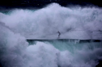 Jeremy Wilmotte takes on a wild and unruly offshore wave south of Coogee Beach on Sunday.