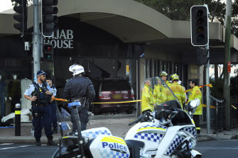 Police and emergency workers stand in front of  Hijab House in Greenacre after a car drove into a shop, injuring 14 people.