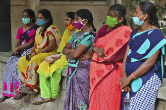 Domestic workers listen during a protest demanding social security from the government in Bengaluru, India.