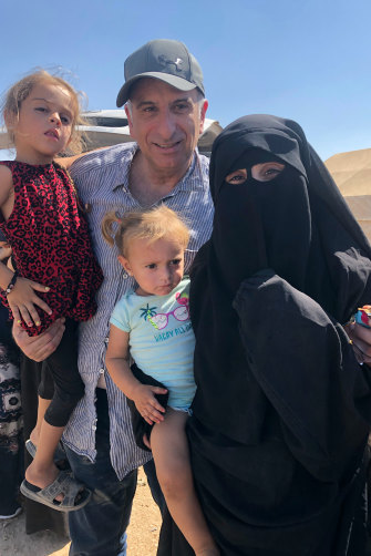 Kamalle with Mariam and her daughters Aisha, left, and Fatema, during his brief visit to the Al-Hol refugee camp in Syria in 2019.
