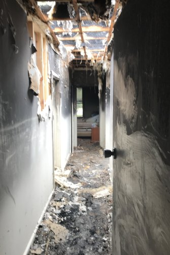 The hallway where firefighters found Neil McMahon in his Melbourne home.