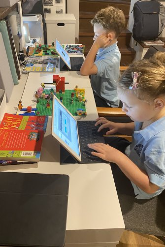 Kate Cooper's kids in their newly-named 'Lilyfield Grammar School' as they work from home.