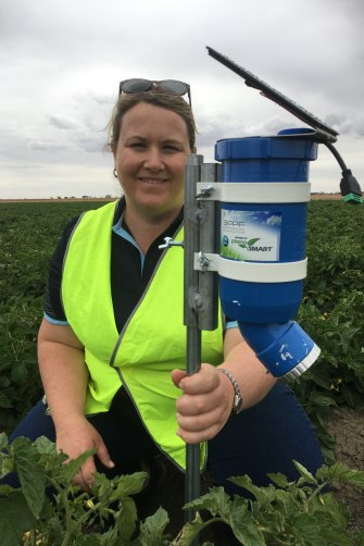 """The CSIRO's Dr Rose Roche with a WaterWise sensor. """"This technology is a massive opportunity to help farmers save water,"""" she says."""