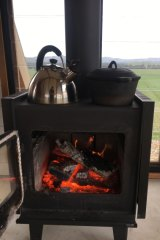 A wood heater keeps JR's Hut cosy on those chilly spring mornings.