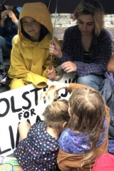 Greta Thunberg (in the yellow raincoat), with Lila and Argenta (front).