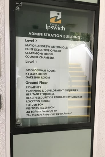 A sign outside Ipswich City Council offices still has sacked mayor Andrew Antoniolli's name.