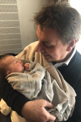 Tony Wright with granddaughter Charlie on the day of her birth in October 2019.