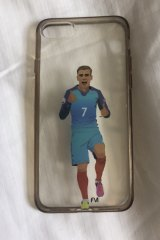 Clubmate: Alex Chidiac's phone cover with an image of Antoine Griezmann, who she has joined at Atletico.