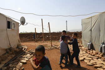 Syrian refugee children play in a temporary refugee camp in the Bekaa Valley, Lebanon.
