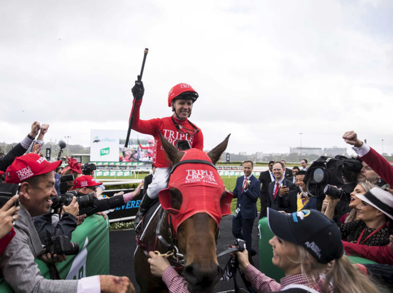 Mind on the job: Kerrin McEvoy raises his whip in victory after Saturday's Everest on Redzel.