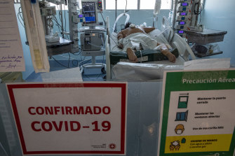 A COVID-19 patient spends Christmas in the Posta Central Hospital in Santiago, Chile. The first shipment of coronavirus vaccines arrived in Chile from Pfizer and its German partner, BioNTech, on December 24.