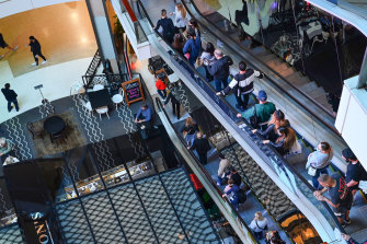 Shoppers pictured at Westfield Bondi Junction this week. Restrictions will ease further when the state reaches 80%.