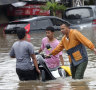 Evacuations as deadly New Year's floods inundate Jakarta