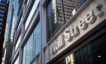 Stocks edged up on Wall Street; Treasury yields keep rallying